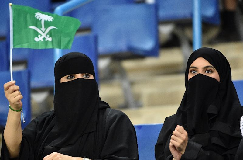 "Saudi women cheer for their football team during a friendly match between Saudi Arabia and Iraq for the ""Superclassico"" championship at King Saud University Stadium in Riyadh on October 15, 2018 (AFP Photo/FAYEZ NURELDINE)"