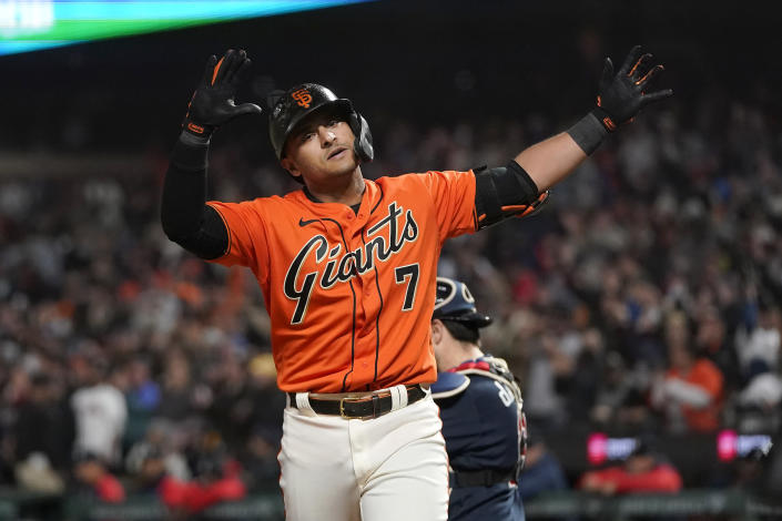 San Francisco Giants' Donovan Solano reacts after hitting a home run against the Atlanta Braves during the ninth inning of a baseball game in San Francisco, Friday, Sept. 17, 2021. (AP Photo/Jeff Chiu)