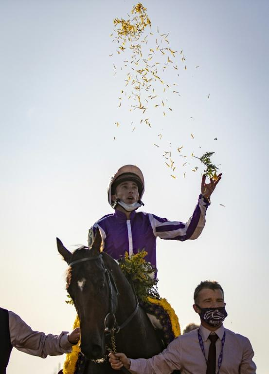 Pierre-Charles Boudot, riding Order of Australia, celebrates after winning the Breeders' Cup Mile at Keenland in Lexington, Kentucky