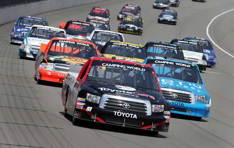 Kyle Busch leads the field during the NASCAR Camping World Truck series Michigan National Guard 200 auto race at Michigan International Speedway in Brooklyn, Mich, Saturday, Aug. 17, 2013. (AP Photo/Bob Brodbeck)