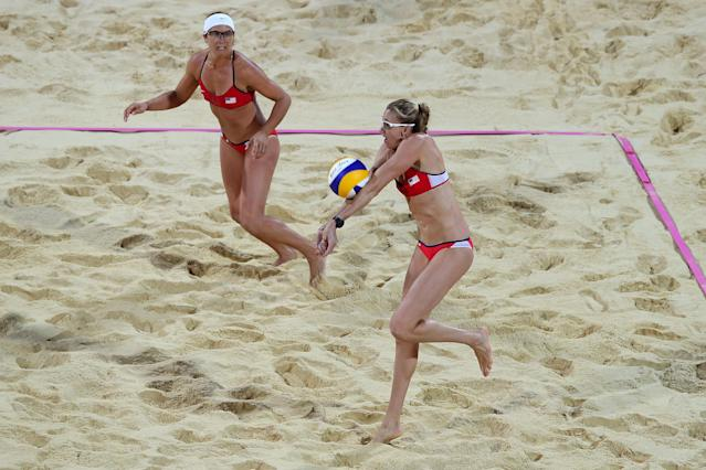 LONDON, ENGLAND - AUGUST 08: Misty May-Treanor (L) watches as Kerri Walsh Jennings of the United States controls the ball during the Women's Beach Volleyball Gold medal match against the United States on Day 12 of the London 2012 Olympic Games at the Horse Guard's Parade on August 8, 2012 in London, England. (Photo by Ryan Pierse/Getty Images)