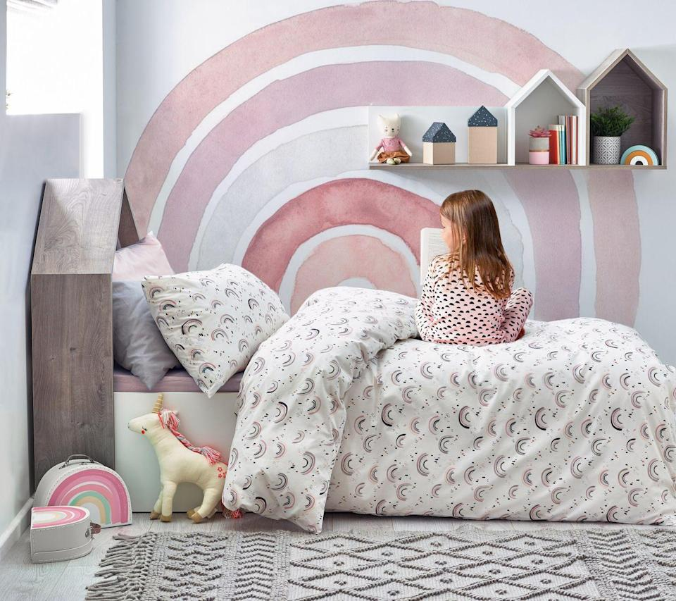 """<p>Rainbows are a big hit right now when it comes to little girls' bedrooms and it's easy to see why – they're full of vibrant colours and hope. But we also love this version too with a more subtle colour palette. The rainbow on the wall is a fabulous idea. You could create this with a roller and three to four colours.</p><p>Pictured: Shop children's bedding at <a href=""""https://www.next.co.uk/shop/department-homeware-productaffiliation-childrensbedding-0"""" rel=""""nofollow noopener"""" target=""""_blank"""" data-ylk=""""slk:Next"""" class=""""link rapid-noclick-resp"""">Next</a></p>"""