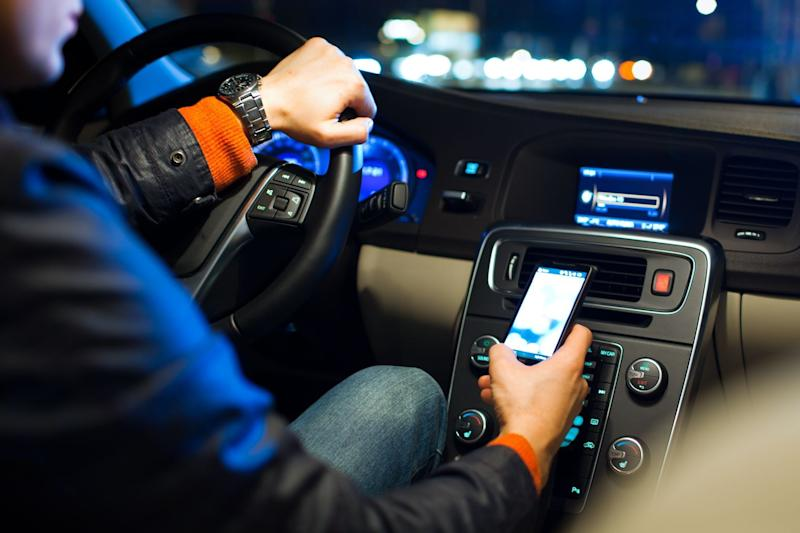 Drivers using a phone at the wheel has reached 'epidemic proportions' in the U.K.