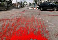 Protestors in Myanmar daubed roads with red paint to demonstrate against the military's bloody crackdown