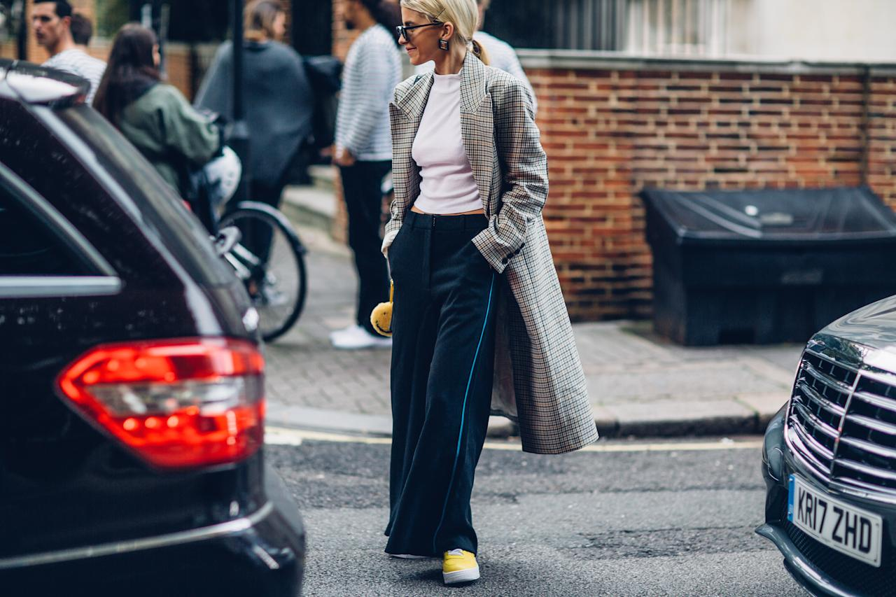 <p>Keeping it casual in wide-leg trousers and yellow trainers, this fashionista at least looked comfortable. </p>