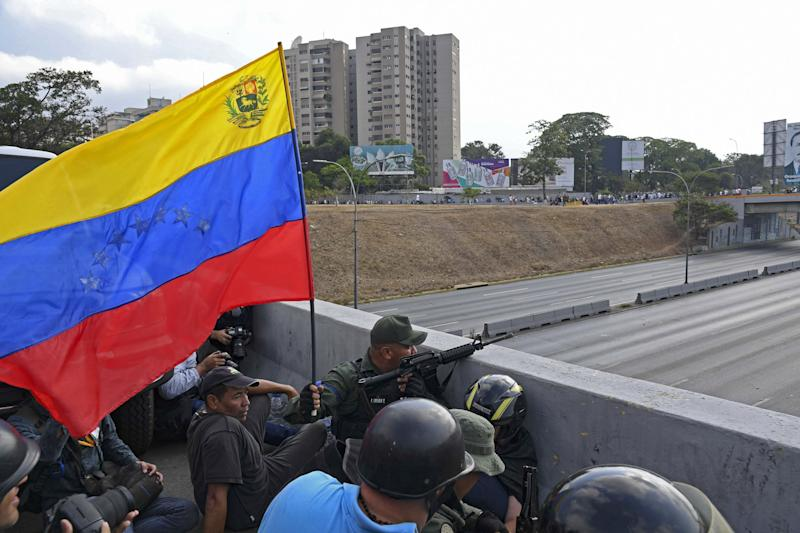 Soldiers loyal to Venezuelan opposition leader and self-proclaimed acting president Juan Guaido take position in front of La Carlota base in Caracas on April 29, 2019. - Venezuelan opposition leader and self-proclaimed acting president Juan Guaido said on Tuesday that troops had joined his campaign to oust President Nicolas Maduro as the government vowed to put down what it called an attempted coup. (Photo: Yuri Cortez/AFP/Getty Images)