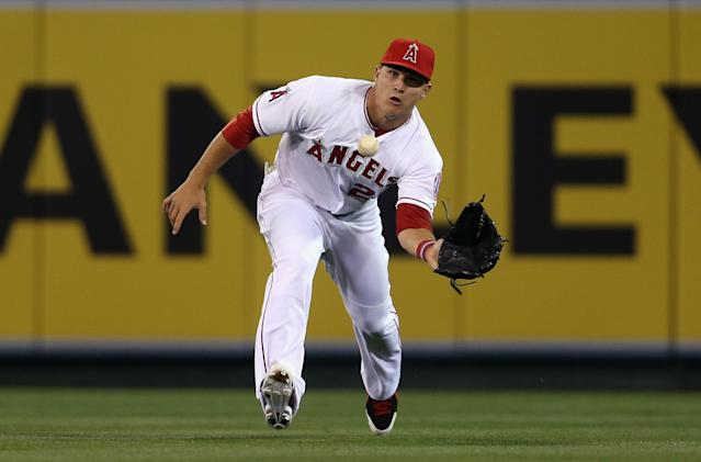 ANAHEIM, CA - MARCH 31: Center fielder Mike Trout #27 of the Los Angeles Angels of Anaheim makes a catch on a ball hit by Abraham Almonte #36 of the Seattle Mariners in the fifth inning during Opening Day at Angel Stadium of Anaheim on March 31, 2014 in Anaheim, California. (Photo by Jeff Gross/Getty Images)