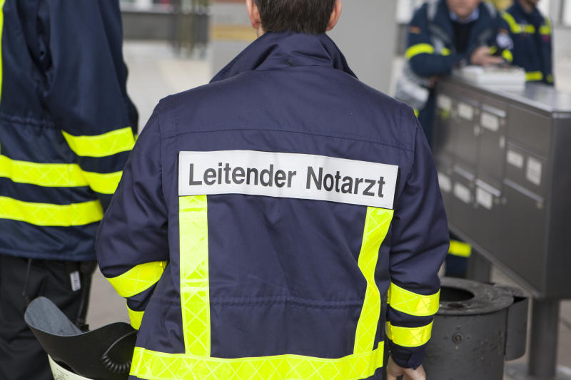 Wiesbaden, Germany - October 25, 2014: Emergency doctor in charge at casualty collection point (Verletztensammelstelle) during a large mass casualty incident drill with German emergency services in the city center of Wiesbaden.