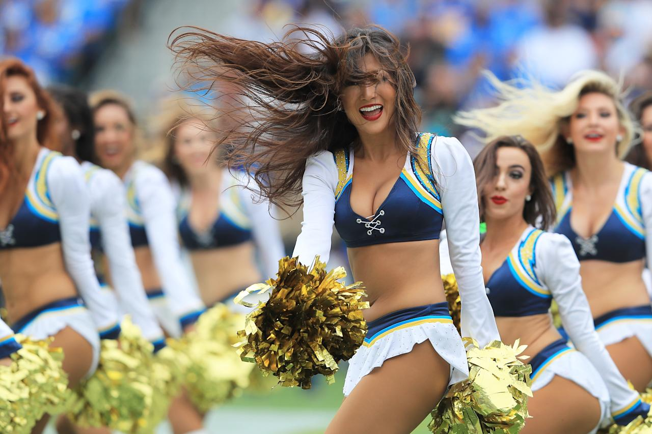 <p>The Los Angeles Chargers girls perform during the game between the Los Angeles Chargers and the Miami Dolphins at the StubHub Center on September 17, 2017 in Carson, California. (Photo by Sean M. Haffey/Getty Images) </p>