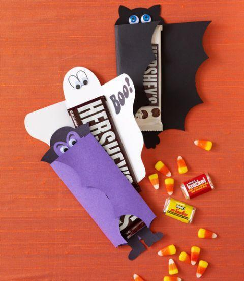 """<p>Enclose sweet treats in these easy-to-make candy wrappers.</p><p><a href=""""https://www.womansday.com/home/crafts-projects/how-to/a6054/halloween-craft-project-cute-candy-wrappers-123900/"""" rel=""""nofollow noopener"""" target=""""_blank"""" data-ylk=""""slk:Get the tutorial for Cute Candy Wrappers."""" class=""""link rapid-noclick-resp""""><em>Get the tutorial for Cute Candy Wrappers.</em></a></p>"""