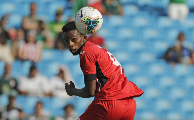 Cuba's Maykel Reyes (9) chases the ball against Canada during the first half of their CONCACAF Golf Cup soccer match in Charlotte, N.C., Sunday, June 23, 2019. (AP Photo/Chuck Burton)