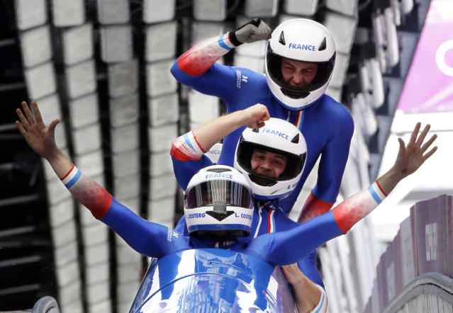 The team from France FRA-1, with Loic Costerg, Romain Heinrich, Florent Ribet and Elly Lefort, react after their final run during the men's four-man bobsled competition final at the 2014 Winter Olympics, Sunday, Feb. 23, 2014, in Krasnaya Polyana, Russia. (AP Photo/Dita Alangkara)
