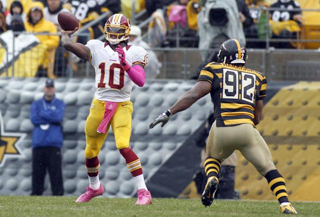 PITTSBURGH, PA - OCTOBER 28: Robert Griffin III #10 of the Washington Redskins passes against James Harrison #92 of the Pittsburgh Steelers during the game on October 28, 2012 at Heinz Field in Pittsburgh, Pennsylvania. The Steelers defeated the Redskins 27-12. (Photo by Justin K. Aller/Getty Images)