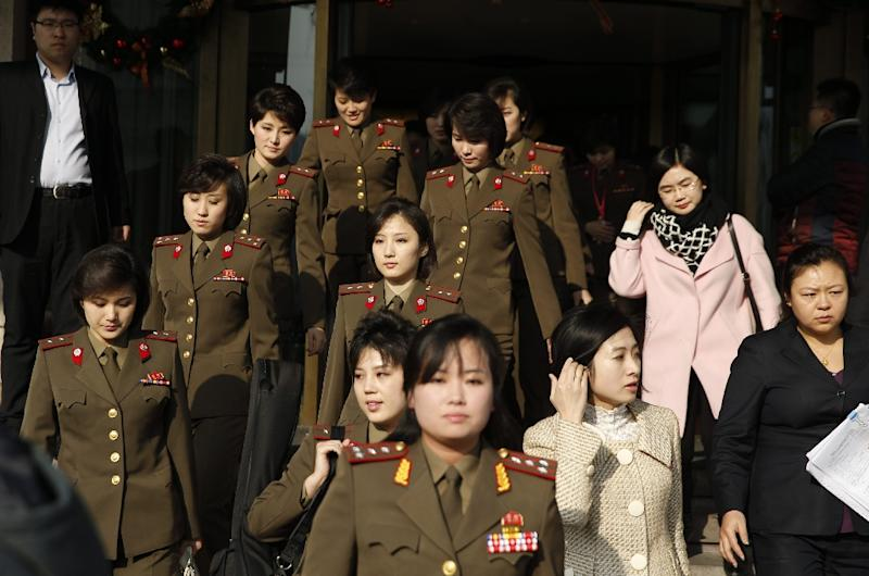 Members from North Korea's Moranbong band walk out of their hotel in Beijing on December 11, 2015