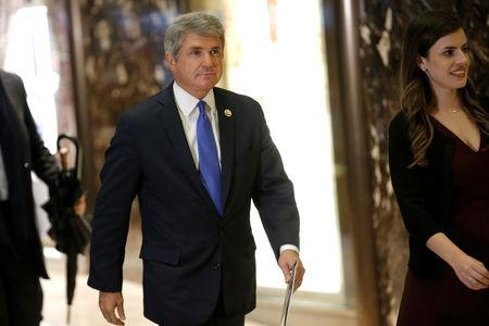 FILE PHOTO - U.S. Representative Michael McCaul (R-TX) is escorted by Madeleine Westerhout as he arrives at Trump Tower to meet with U.S. President-elect Donald Trump