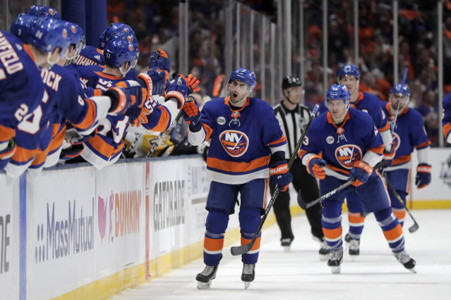 New York Islanders right wing Jordan Eberle shouts as he skates by the bench after scoring a goal against the Pittsburgh Penguins during the third period of Game 2 of an NHL hockey first-round playoff series, Friday, April 12, 2019, in Uniondale, N.Y. The Islanders won 3-1. (AP Photo/Julio Cortez)