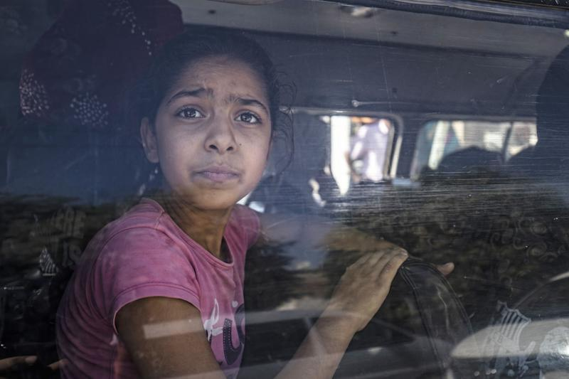Syrian Arab and Kurdish civilians arrive to Hassakeh city after fleeing following Turkish bombardment on Syria's northeastern towns along the Turkish border on Oct. 10, 2019. (Photo: Delil Souleiman/AFP via Getty Images)