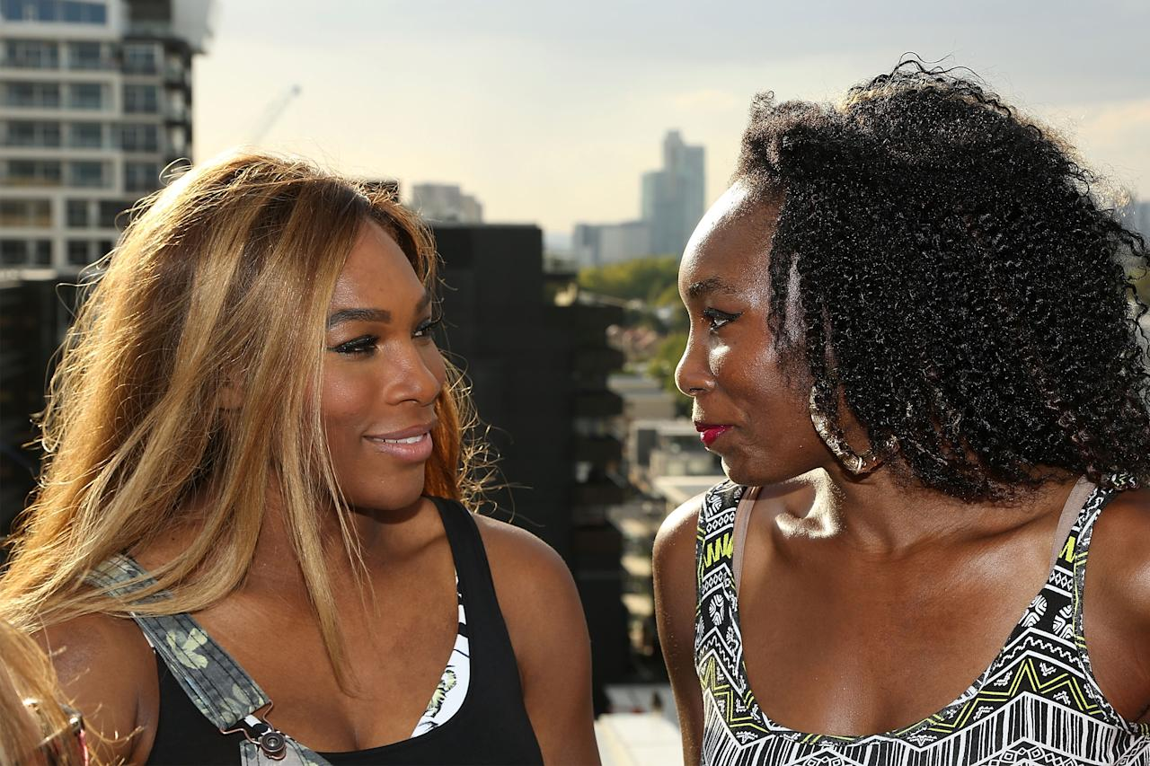 MELBOURNE, AUSTRALIA - JANUARY 09: Venus Williams (L) and Serena Williams of the USA pose during a meet & greet with the Melbourne Renegades at The Olsen on January 9, 2014 in Melbourne, Australia. (Photo by Graham Denholm/Getty Images)