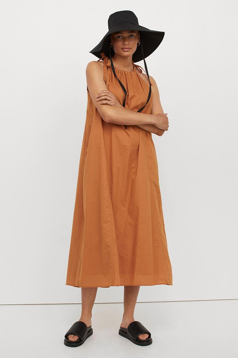 <p>Give your beach wardrobe a stylish upgrade with this loose-fitting, yet extremely put-together, <span>Flared Dress</span> ($36, originally $40). Finish off your look with a large bucket hat and some thick slide sandals.</p>