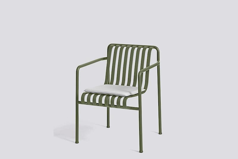 A beautiful, weather-resistant olive chair with cushions available in the same hue (or varying grays). SHOP NOW: Palissade Seat Pad Dining Armchair by Hay, $64 $75, us.hay.com