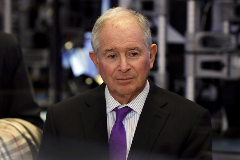 Stephen Schwarzman, chairman, CEO and co-founder of the investment firm Blackstone, waits to be interviewed on the floor of the New York Stock Exchange, Tuesday, Oct. 8, 2019. (AP Photo/Richard Drew)