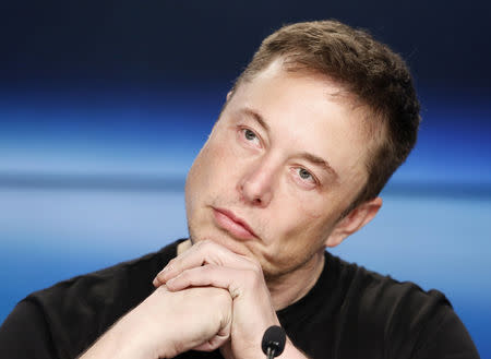 SpaceX founder Elon Musk listens at a press conference following the first launch of a SpaceX Falcon Heavy rocket at the Kennedy Space Center in Cape Canaveral, Florida, U.S., February 6, 2018. REUTERS/Joe Skipper/Files