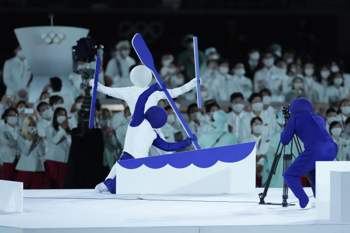 <p>Actors perform during the opening ceremony in the Olympic Stadium at the 2020 Summer Olympics, Friday, July 23, 2021, in Tokyo, Japan. (AP Photo/Ashley Landis)</p>