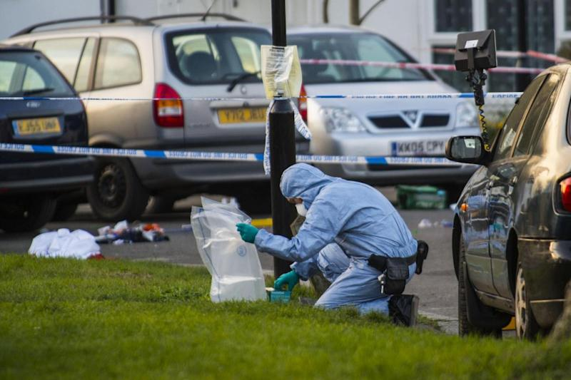 Forensic investigation: Officers comb the scene after a young man became the second to be fatally stabbed on the streets of the capital within 24 hours. (Lucy Young)