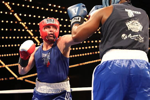 "<p>Mark ""Muscle Shark"" Sinatra extends a punch against Erin Fitchette in the Super Heavy Champ class of the NYPD Boxing Championships at the Theater at Madison Square Garden on June 8, 2017.(Photo: Gordon Donovan/Yahoo News) </p>"