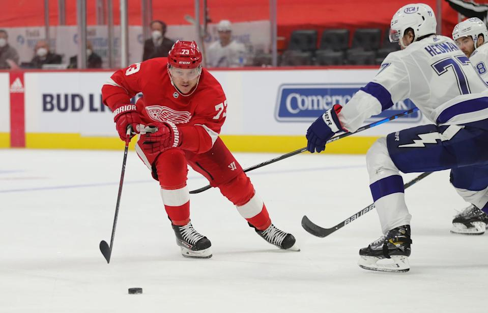 Red Wings left wing Adam Erne goes for the puck against Lightning defenseman Victor Hedman during the third period of the Wings' 1-0 shootout win on Saturday, May 1, 2021, at Little Caesars Arena.