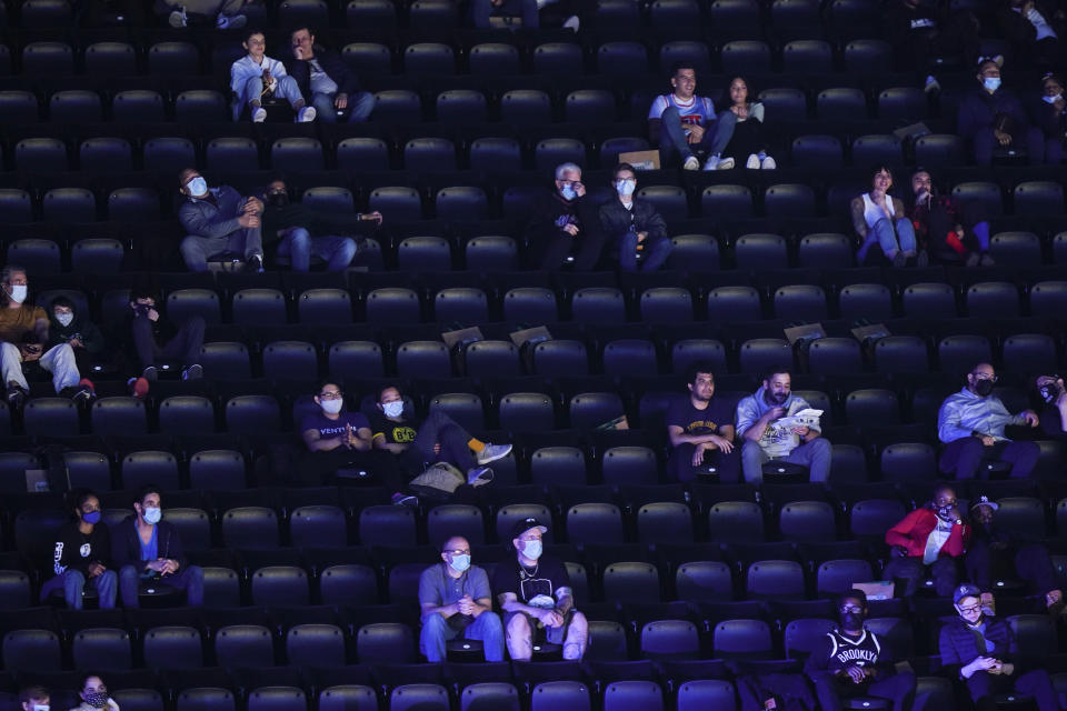 Fans watch during the first half of an NBA basketball game between the Brooklyn Nets and the San Antonio Spurs at Barclays Center Wednesday, May 12, 2021, in New York. (AP Photo/Frank Franklin II)
