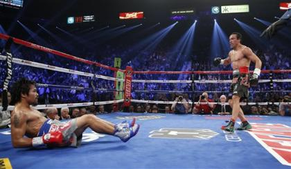 Juan Manuel Marquez, from Mexico, left, knocks down Manny Pacquiao, from the Philippines, in the third round of their WBO world welterweight fight Saturday, Dec. 8, 2012, in Las Vegas. (AP Photo/Eric Jamison)