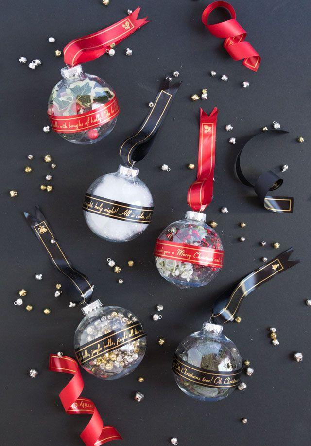 """<p>Purchase ribbons already printed with messages, or use a special label maker, so you can make your own greetings. </p><p><em>Get the tutorial at <a href=""""https://designimprovised.com/2019/12/ribbon-christmas-ornaments-with-brother-p-touch-embellish-elite.html"""" rel=""""nofollow noopener"""" target=""""_blank"""" data-ylk=""""slk:Design Improvised"""" class=""""link rapid-noclick-resp"""">Design Improvised</a>.</em></p><p><a class=""""link rapid-noclick-resp"""" href=""""https://www.amazon.com/Brother-Embellish-Connectable-Decorative-PT-P715eBT/dp/B08DDCBDZ5?tag=syn-yahoo-20&ascsubtag=%5Bartid%7C10072.g.34443405%5Bsrc%7Cyahoo-us"""" rel=""""nofollow noopener"""" target=""""_blank"""" data-ylk=""""slk:SHOP LABEL MAKER"""">SHOP LABEL MAKER</a></p>"""