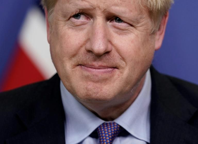 After agreeing a new divorce deal with European leaders in Brussels, British Prime Minister Boris Johnson must now persuade sceptical MPs at home to approve it (AFP Photo/Kenzo TRIBOUILLARD)
