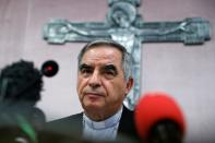 FILE PHOTO: Cardinal Giovanni Angelo Becciu speaks to the media in Rome