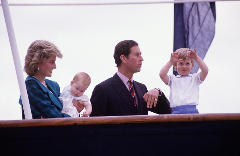 Diana Princess of Wales and Charles Prince of Wales hold Prince Harry and Prince William on the deck of the Royal Yacht Britannia, during the Royal Tour of Italy on May 5, 1985 in Venice Italy.