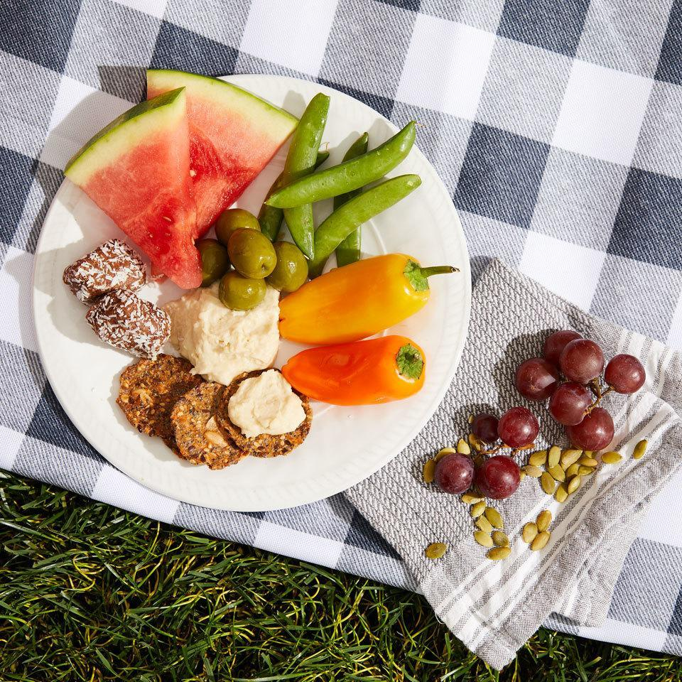 """<p>Fresh veggies with dip, juicy fruit and even a sweet treat make up this easy-to-make picnic dinner that's great for packing up or enjoying at home. Plus, this combo excludes the most common allergens and food intolerances (it's free from dairy, eggs, soy, nuts and gluten) so just about everyone should be able to enjoy it without worrying. <a href=""""https://www.eatingwell.com/recipe/264493/sweet-savory-hummus-plate/"""" rel=""""nofollow noopener"""" target=""""_blank"""" data-ylk=""""slk:View Recipe"""" class=""""link rapid-noclick-resp"""">View Recipe</a></p>"""