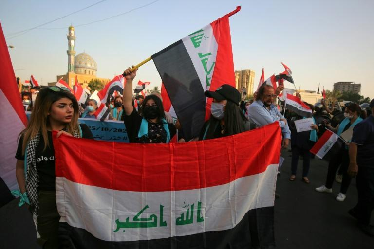 Iraqis demonstrate in Baghdad's Al-Firdous Square on October 1 during a commemoration of the mass anti-government protest movement that started a year ago