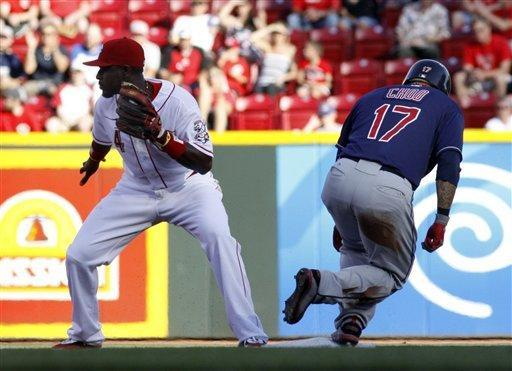 Cincinnati Reds' Brandon Phillips waits for the throw from the outfield as Cleveland Indians' Shin-Soo Choo makes it to second base on a double in the first inning during their interleague baseball game in Cincinnati, Tuesday, June 12, 2012. (AP Photo/Tom Uhlman)