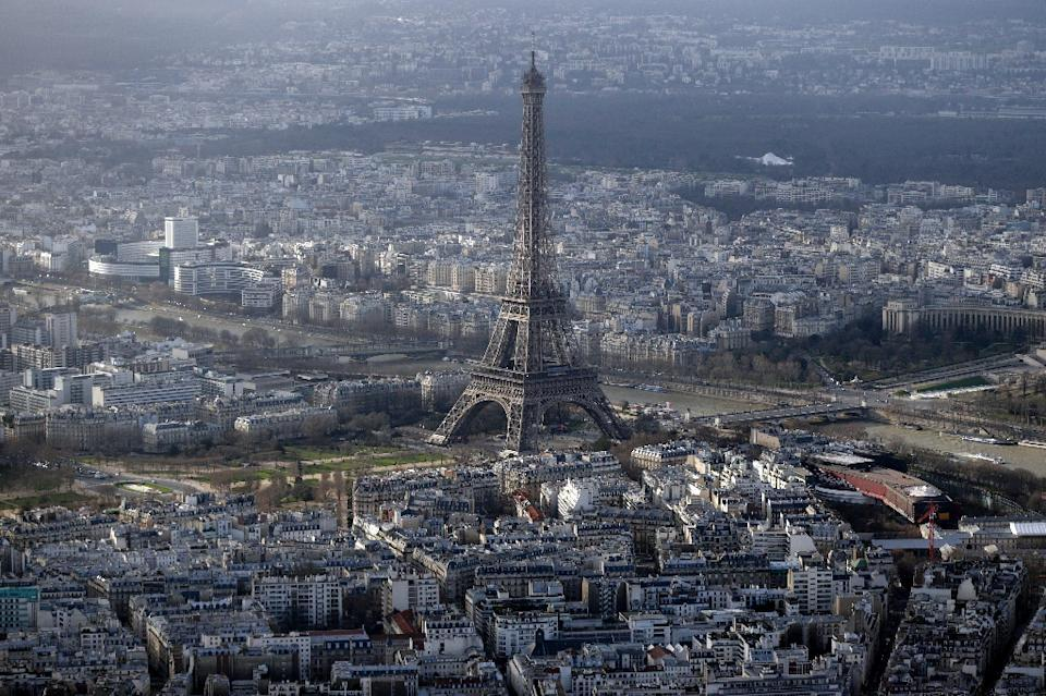 France has launched a one-million-euro programme aimed at detecting and intercepting pilotless drones that fly over Paris landmarks such as the Eiffel Tower (AFP Photo/Kenzo Tribouillard)