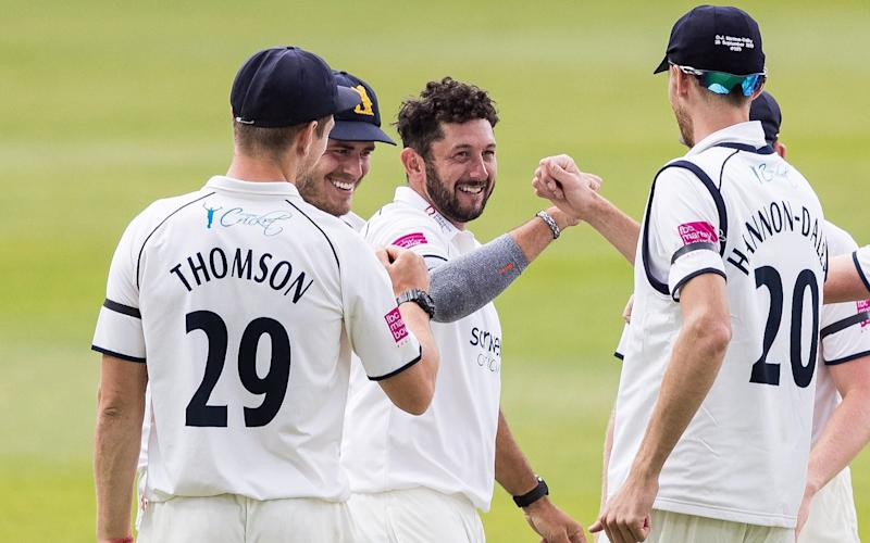 Tim Bresnan of Warwickshire celebrates with his team mates after taking the wicket of Ricardo Vasconcelos of Northamptonshire during day one of the Bob Willis Trophy match between Warwickshire and Northamptonshire at Edgbaston on August 01, 2020 in Birmingham, England. - GETTY IMAGES