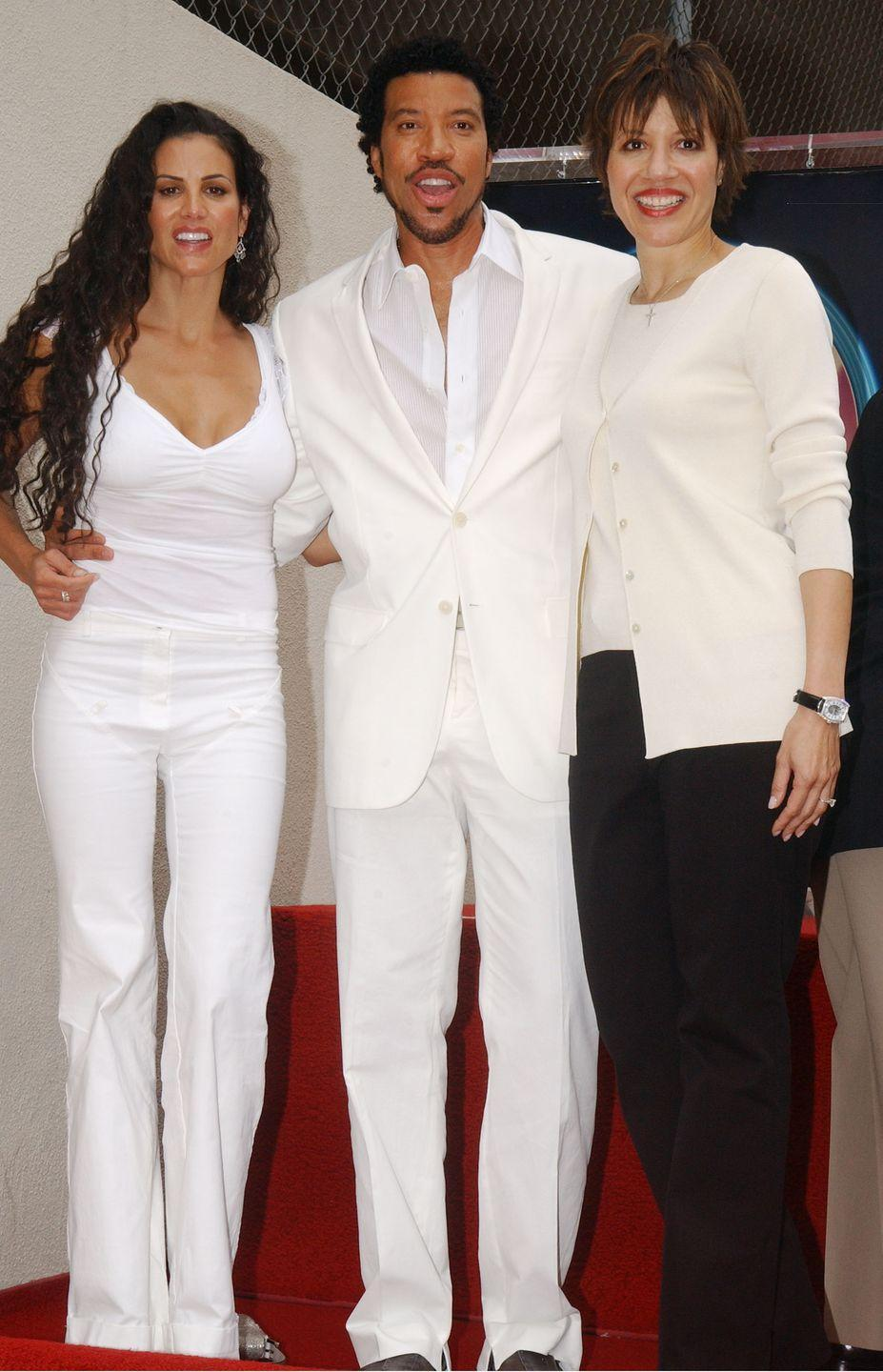 <p>It isn't just the all-white outfit: Lionel Richie and his sister Deborah Richie look a <em>lot </em>alike even when they're not dressed similarly. We'd have to credit their wide smiles for that. </p>