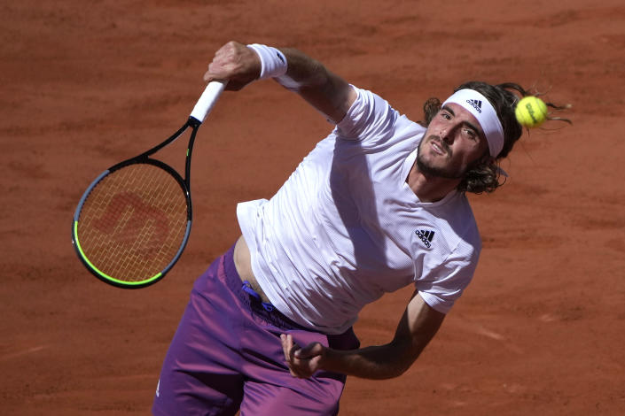 Stefanos Tsitsipas of Greece serves the ball to Serbia's Novak Djokovic during their final match of the French Open tennis tournament at the Roland Garros stadium Sunday, June 13, 2021 in Paris. (AP Photo/Christophe Ena)