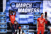 Syracuse forward Alan Griffin (0) and Jesse Edwards (14) watch from the bench against Houston in the second half of a Sweet 16 game in the NCAA men's college basketball tournament at Hinkle Fieldhouse in Indianapolis, Saturday, March 27, 2021. Houston won 62-46. (AP Photo/Michael Conroy)