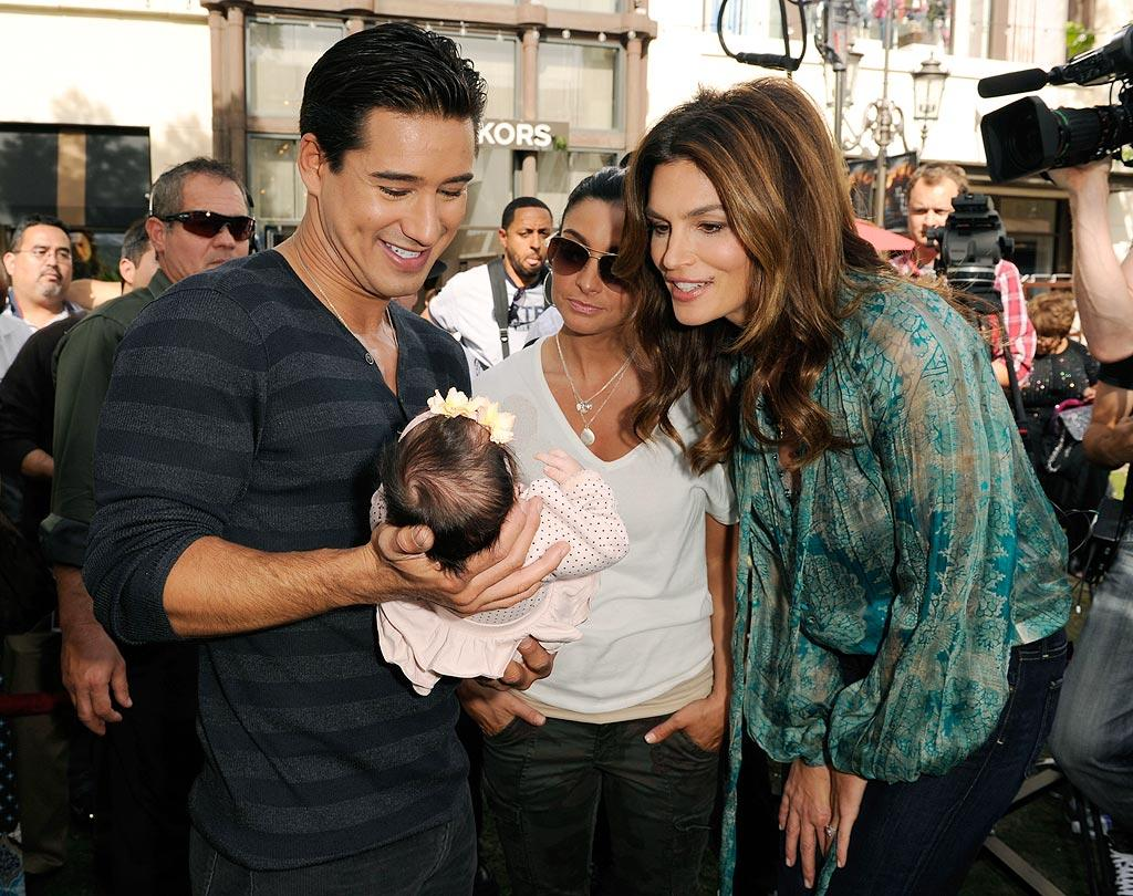"""Proud daddy Mario Lopez, with girlfriend Courtney Mazza, showed off his 1-month-old baby daughter, Gia Francesca Lopez, to model Cindy Crawford during a taping of Lopez's show, """"Extra,"""" at The Grove in L.A. Monday. One day before, the new parents celebrated Gia's arrival with a baby shower. """"Making my true daddy debut today at Gia's baby shower thrown by @pampers. So many gifts! Thanks to everyone!"""" tweeted Lopez. Michael Caulfield/<a href=""""http://www.gettyimages.com/"""" target=""""new"""">GettyImages.com</a> - October 25, 2010"""