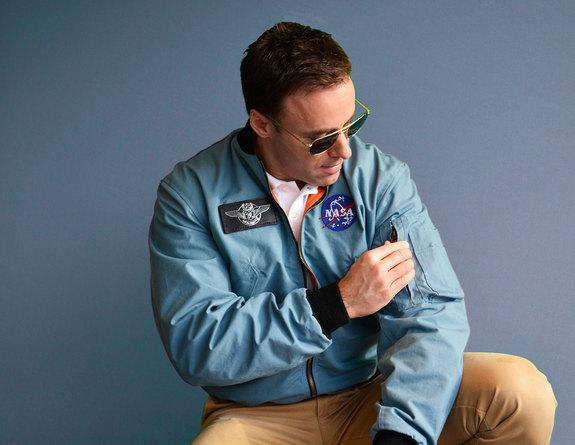 A model poses wearing Still The Right Stuff's replica Apollo flight jacket, which faithfully reproduces the iconic NASA coat.