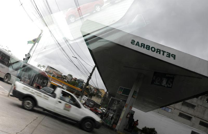 FILE PHOTO: A Petrobras gas station is pictured reflected in a car window in the outskirts of Sao Paulo