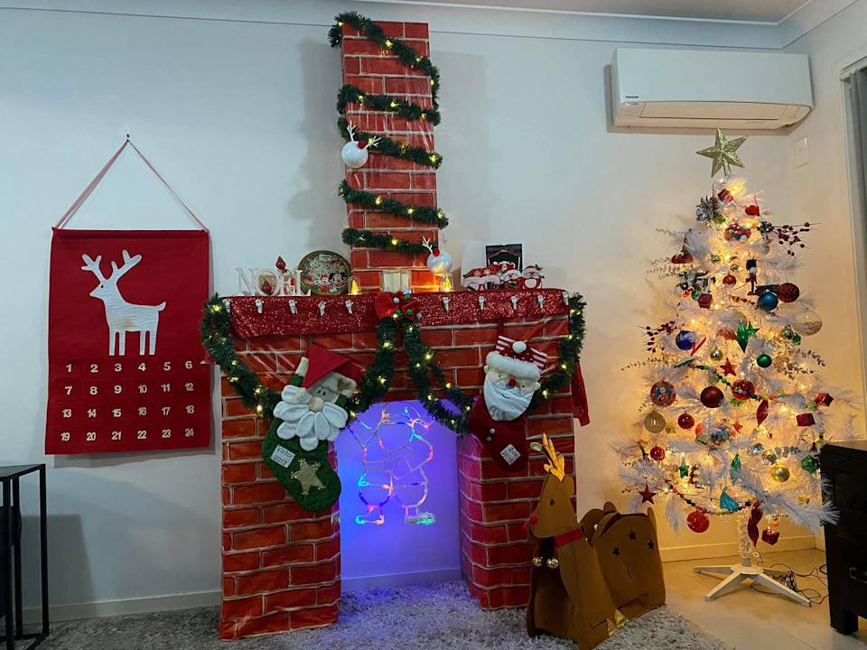 A mum has shared her Christmas hack to create a fireplace in her living room. Photo: Facebook