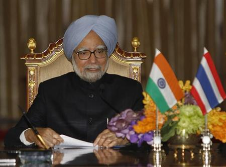 India's PM Singh speaks during a news conference at the Government House in Bangkok
