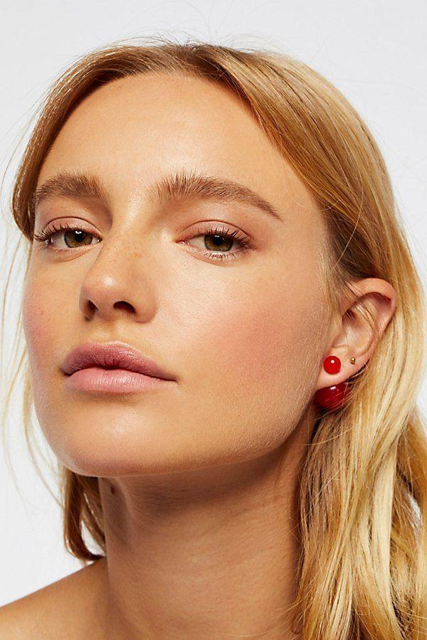 """Unique, bold, and they come in six different mirrored styles. <a href=""""https://www.freepeople.com/shop/double-sided-orbit-studs/?color=046&quantity=1&size=One%20Size&type=REGULAR"""" target=""""_blank"""">Shop them here</a>."""